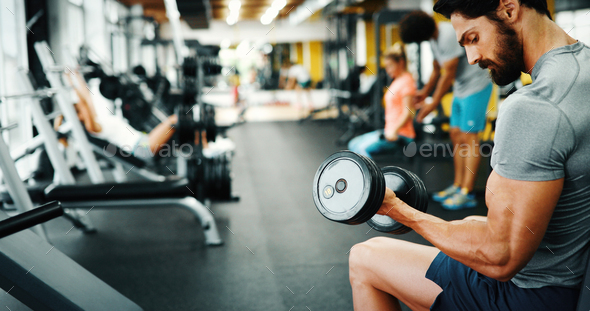 Muscular bodybuilder guy doing exercises - Stock Photo - Images