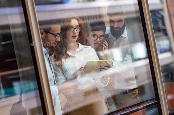 Picture of young businesspeople talking in elevator - Stock Photo - Images