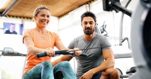 Personal trainer helping - Stock Photo - Images