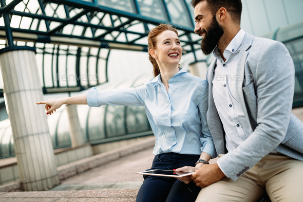Picture of man and beautiful woman as business partners - Stock Photo - Images