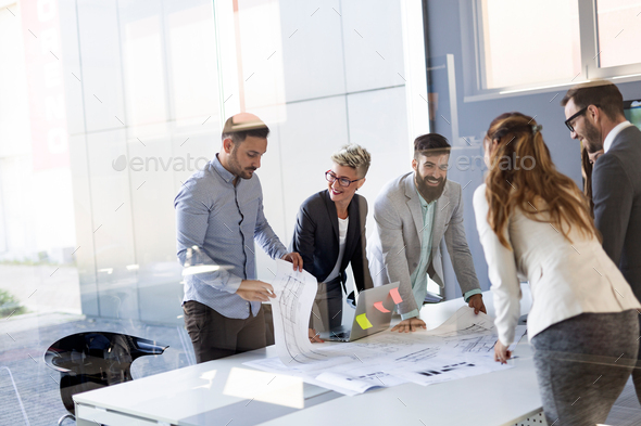 Group of architects and business people working together and brainstorming - Stock Photo - Images