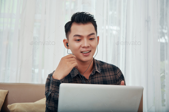 Asian man having video call at home - Stock Photo - Images