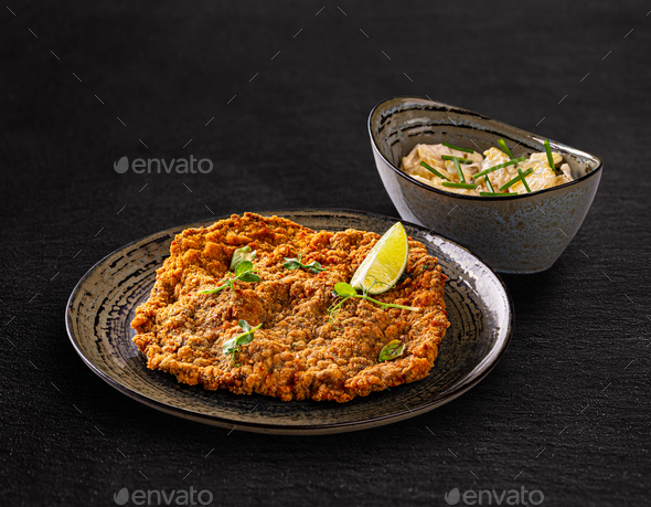 Giant veal viennese schnitzel - Stock Photo - Images