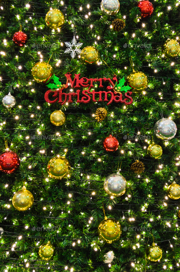 Merry Christmas sign on the tree - Stock Photo - Images