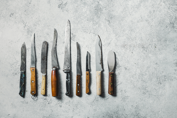 Old knifes on a grey background - Stock Photo - Images