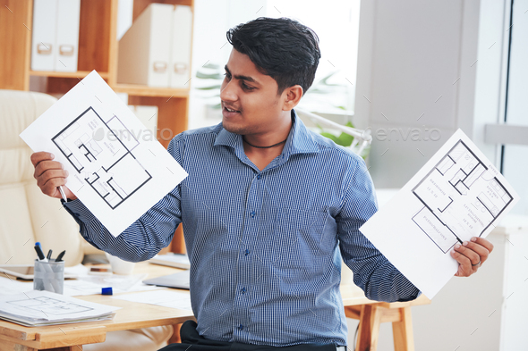 Engineer showing apartment plans - Stock Photo - Images
