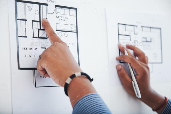 Engineer checking blueprint - Stock Photo - Images