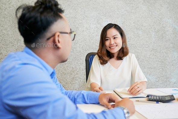 Smiling woman working with man in team - Stock Photo - Images