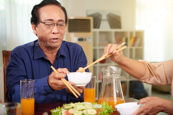 Aged man at family dinner - Stock Photo - Images