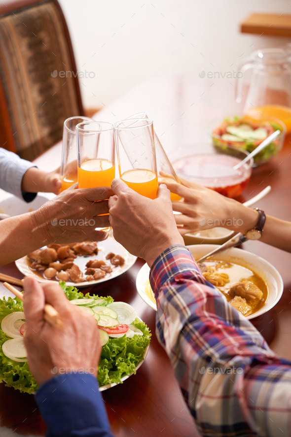 Family toasting at table - Stock Photo - Images