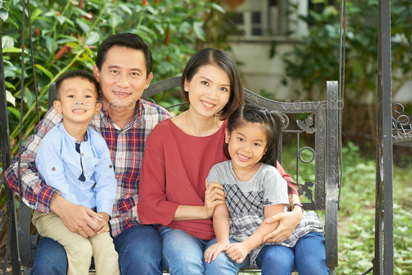 Happy family of four - Stock Photo - Images