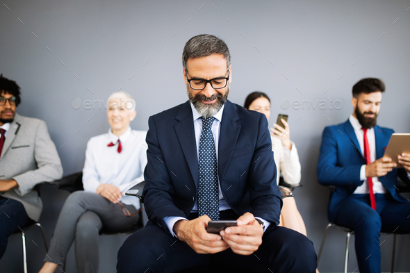 Senior business people using mobile phone. Telecommunication technology and internet of things - Stock Photo - Images