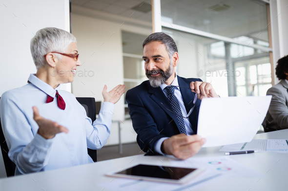 Business people working discussing as a team at the office - Stock Photo - Images