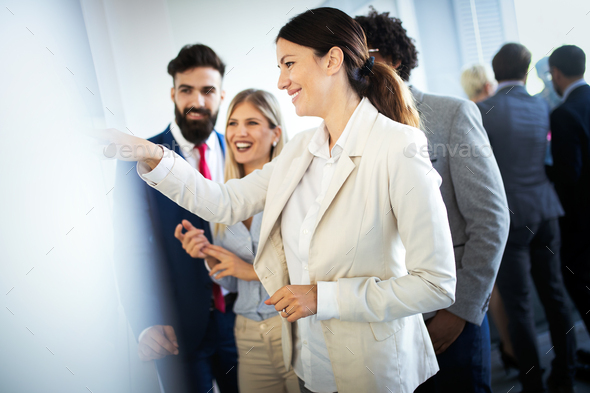 Group of business people discussing, brainstorming in office. Concentrated at work - Stock Photo - Images