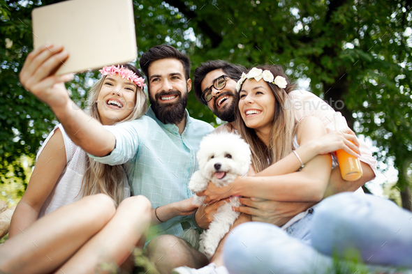 Group of young people taking a selfie outdoors, having fun - Stock Photo - Images