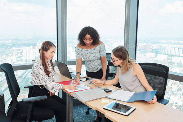Female managers discussing new trends in sales - Stock Photo - Images