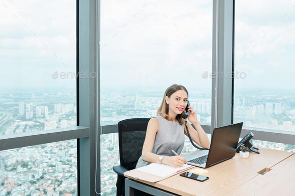 Female entrepreneur talking on phone - Stock Photo - Images