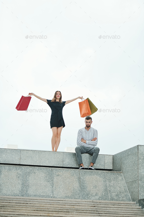 Young couple after shopping - Stock Photo - Images