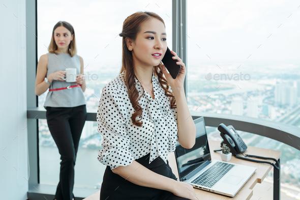 Female entrepreneur making phone call - Stock Photo - Images