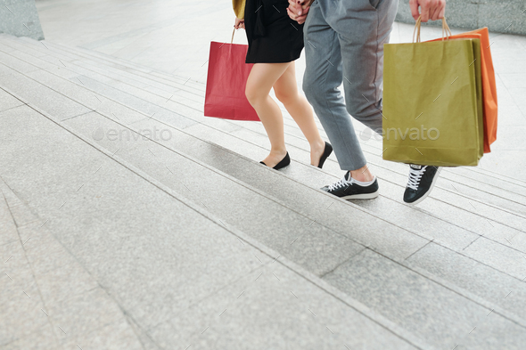 Couple running to mall - Stock Photo - Images