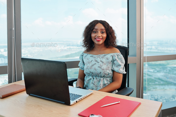 Businesswoman at office desk - Stock Photo - Images