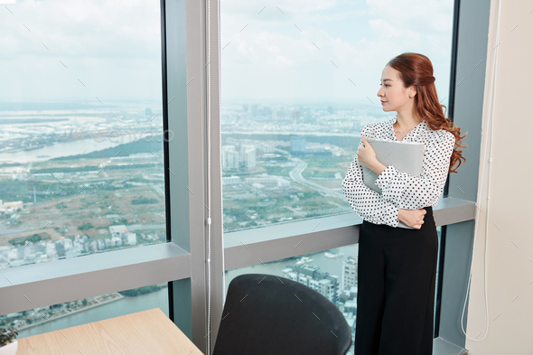 Pensive young business lady - Stock Photo - Images