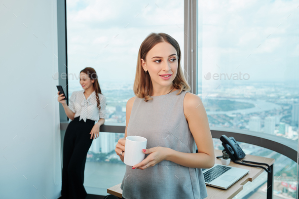 Business lady with mug of coffee - Stock Photo - Images