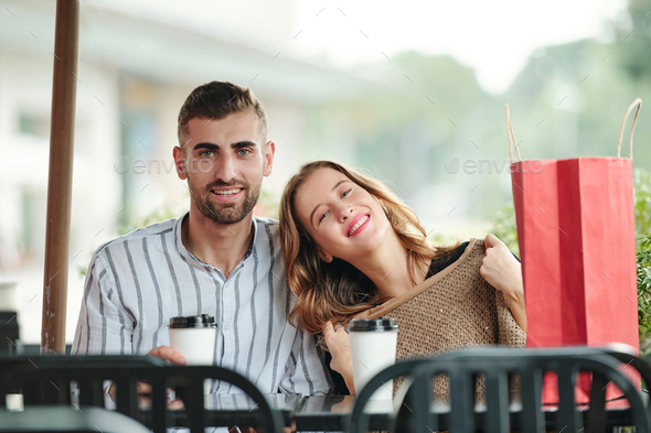 Happy couple spending time in cafe - Stock Photo - Images