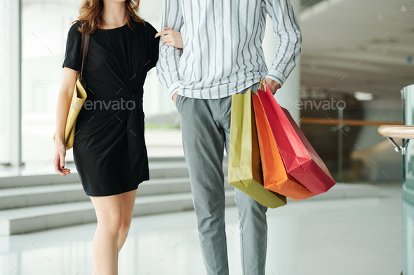 Walking couple after shopping - Stock Photo - Images