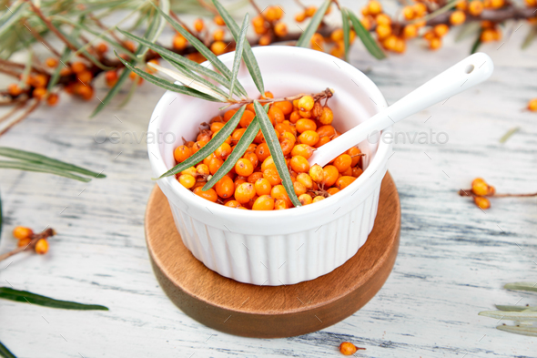 Natural, organic sea buckthorn berry in bowl - Stock Photo - Images