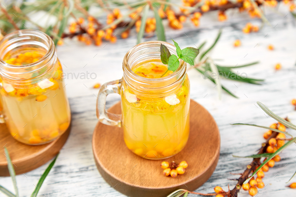 Hot sea buckthorn tea with ginger and honey - Stock Photo - Images