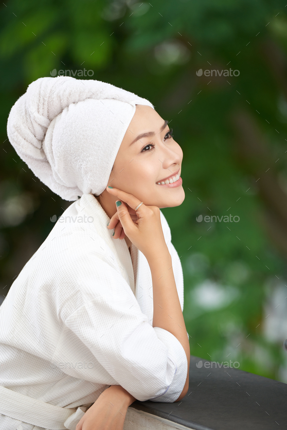 Sensual young woman in bathrobe after bath - Stock Photo - Images