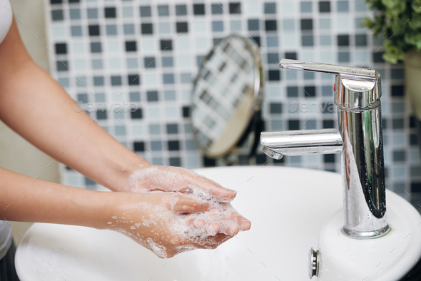 Crop woman washing hands with soap foam - Stock Photo - Images