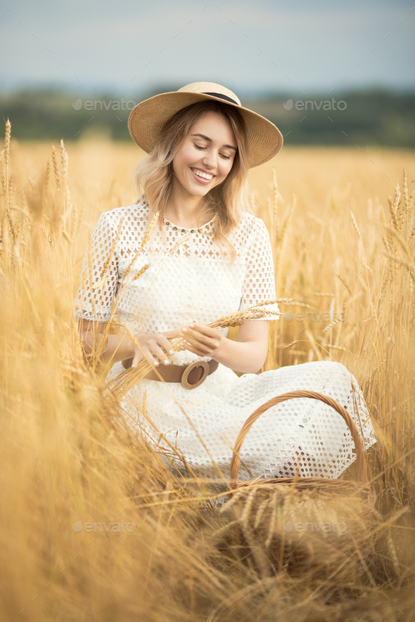 Young Attractive Woman And Golden Wheat Field. Harvest Concept. - Stock Photo - Images