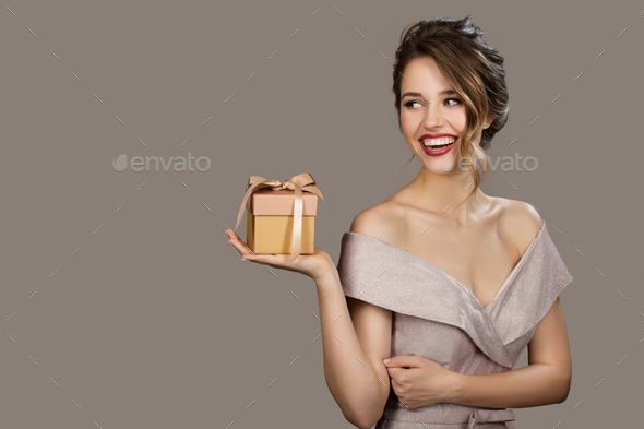 Portrait Of Smiling Pretty Woman Holding A Gift Box In Hands. - Stock Photo - Images