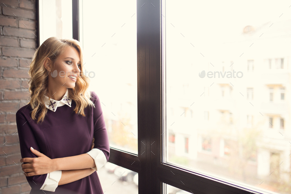 Attractive Young Woman Near Window At Home - Stock Photo - Images