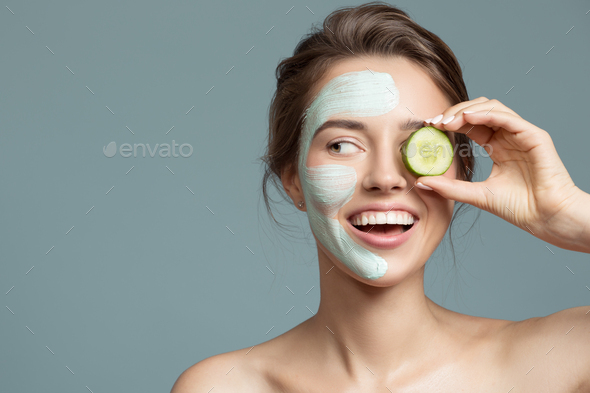 Portrait Of Beautiful Woman With Blue Cream Mask On Her Face. - Stock Photo - Images