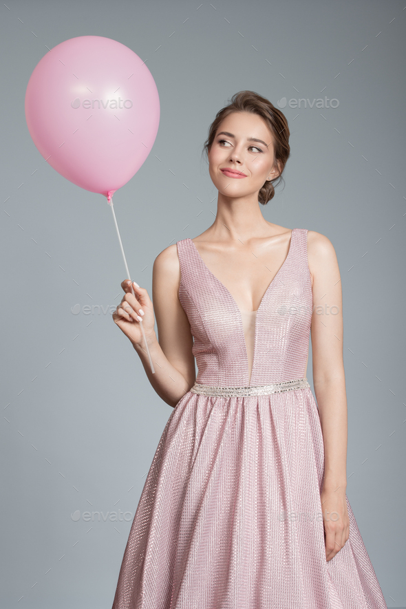 Portrait Of Smiling Woman. Holding Pink Balloon In Her Hand. - Stock Photo - Images