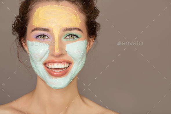 Portrait Of Beautiful Woman With Colorful Cream Mask On Her Face - Stock Photo - Images