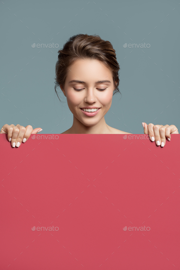 Attractive Smiling Woman Holding Red Empty Paper Blank - Stock Photo - Images