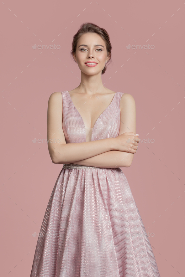 Beautiful Smiling Woman In Pink Dress. Rose Background. - Stock Photo - Images