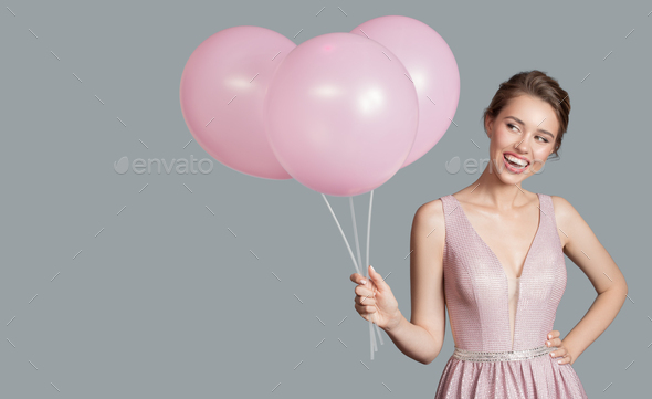 Portrait Of Smiling Woman. Holding Pink Balloons In Her Hand. - Stock Photo - Images