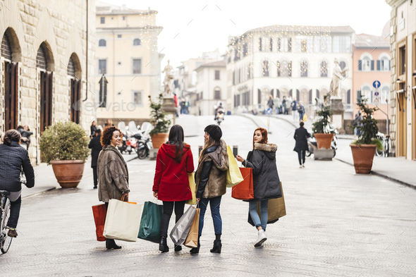 Happy female group of friends doing shopping together - Stock Photo - Images