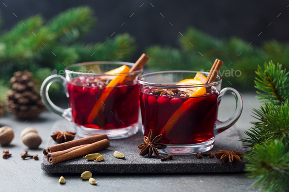 Mulled Red Wine with Spices. Christmas Decoration. Grey Stone Background. - Stock Photo - Images