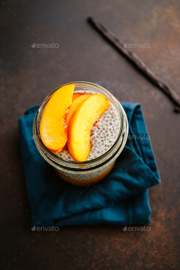 Portion healthy vegan chia pudding with almond milk, vanilla and peaches - Stock Photo - Images