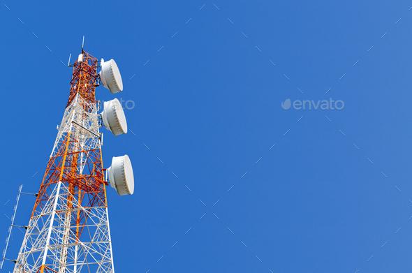 Telecommunication tower on blue sky background - Stock Photo - Images