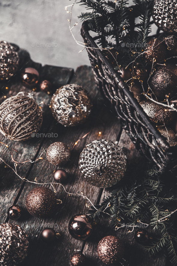 vintage christmas, new Year toys and decoration in basket on brown wooden table, copy space - Stock Photo - Images