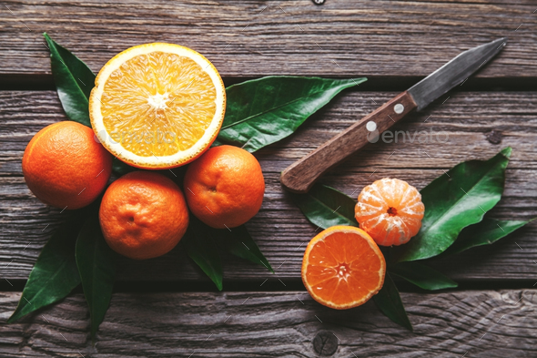 tangerines with a knife on a wooden background. Healthy food. Fruit - Stock Photo - Images