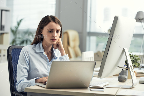 Business woman reading e-mail - Stock Photo - Images