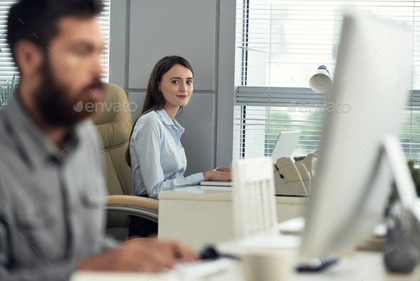 Positive business woman working in office - Stock Photo - Images